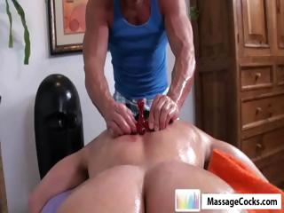 Studly masseuse gives gay boy Dylan a deep massage in the matter of toys