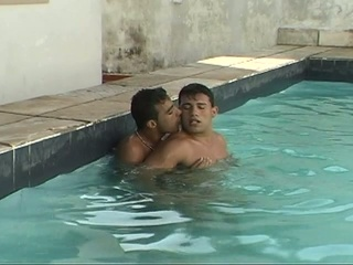Horny gay dudes making out with reference to the pool