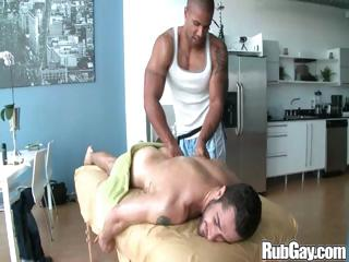 Tired gay rugby player gets a accurate relaxing massage exceeding his back and ass from a masseur stud