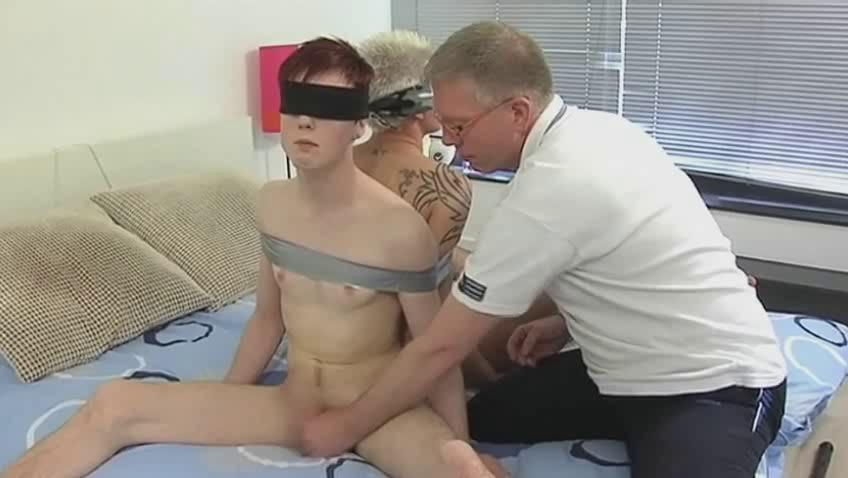 Mature gay daddy ties two randy twinks and suck their dicks