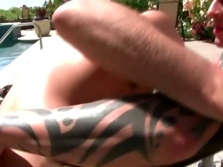 Poolside blowjob for this horny gay couple