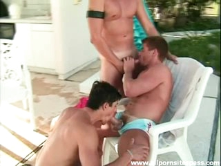 Three dudes gobble cock outdoors