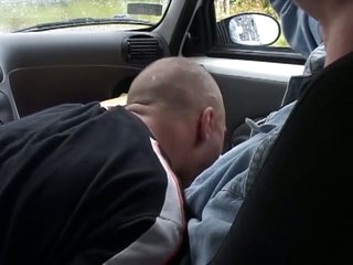Horny dude gets a blowjob in eradicate affect car