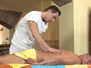 Cute twink gets a lusty massage from shocking gay dude