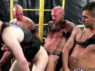 gay dudes are wearing some leather and being dominant
